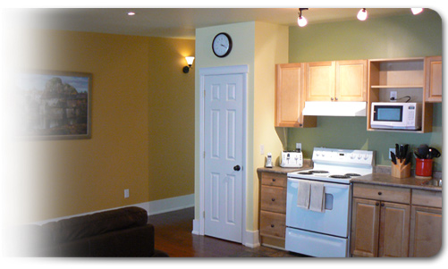 Kitchen and Hallway in a Cader Lofts Short Term Furnished Apartment for rent in Peterborough